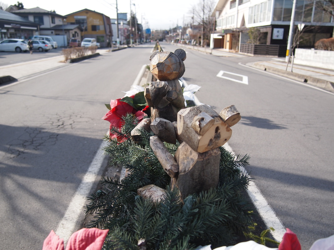 Wooden bears decoration extents along the center zone of Route 18 near the Karizawa Station on Dec 24, 2015
